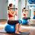 pilates · mujer · pelota · ejercicio · entrenamiento · gimnasio - foto stock © lunamarina
