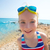 engraçado · menina · jogar · enterrado · areia · da · praia · sorridente - foto stock © lunamarina