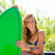blond teen surfer girl with green surfboard on car stock photo © lunamarina