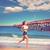 beautiful brunette girl running in california beach stock photo © lunamarina