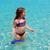 agua · agua · playa · púrpura · bikini · nina - foto stock © lunamarina