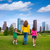 mother and daughters walking holding hands on city skyline stock photo © lunamarina