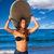 brunette surfer teen girl holding surfboard in a beach stock photo © lunamarina