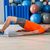 hip lift with blond man at gym workout stock photo © lunamarina