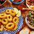 tintahal · gyűrűk · étel · étterem · paradicsom · ebéd - stock fotó © lunamarina