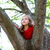 children kid girl playing climbing to a tree in a park stock photo © lunamarina