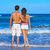 young couple standing looking at the beach rear stock photo © lunamarina