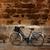 bicycle in historical ciutadella stone wall at balearics stock photo © lunamarina