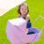 toddler kid girl playing with baby cart in green turf stock photo © lunamarina
