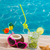 mojito cocktail on beach sand with coconut and sunglasses stock photo © lunamarina