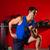 hex dumbbells man workout in red gym stock photo © lunamarina