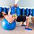 dumbbell chest press on fit ball man workout stock photo © lunamarina