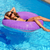 children girl relaxed on purple inflatable pool ring stock photo © lunamarina