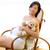 piękna · kobieta · w · ciąży · posiedzenia · miś · biegun · krzesło - zdjęcia stock © lunamarina