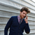 üzletember · beszél · okostelefon · portré · iroda · gesztikulál - stock fotó © lunamarina