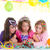 children happy girls blowing birthday party cake stock photo © lunamarina