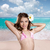 brunette girl in tropical beach with daisy flower happy stock photo © lunamarina