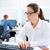 Brunette glasses businesswoman working in office stock photo © lunamarina