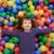 colorful balls funny park little girl lying gesturing stock photo © lunamarina