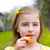 blond kid girl eating corn snacks in outdoor park stock photo © lunamarina