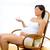 beautiful pregnant woman looking baby shoes at home stock photo © lunamarina