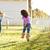 multi ethnic kid girls playing running in park stock photo © lunamarina