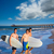 boys surfers group coming out from beach stock photo © lunamarina