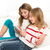 children sister friends kid girls playing together with tablet p stock photo © lunamarina