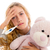 blond girl with thermometer and flu cold in pyjama stock photo © lunamarina