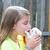 blond kid girl with puppy pet chihuahua playing stock photo © lunamarina