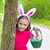easter girl with eggs basket and funny bunny face stock photo © lunamarina