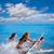 meisjes · bikini · springen · strand · zomer · vakantie - stockfoto © lunamarina
