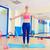 pilates · mulher · em · pé · elástico · exercer · exercício - foto stock © lunamarina