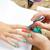 unhas · pintura · mulher · escove · mãos - foto stock © lunamarina