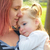 mother and daughter portrait hug kissing in park stock photo © lunamarina