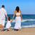 happy family on the beach sand walking rear stock photo © lunamarina