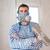 funny plastering man mason with protective mask and trowel stock photo © lunamarina