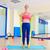 pilates · mulher · bíceps · elástico · exercer · exercício - foto stock © lunamarina
