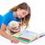 kid girl with puppy chihuahua pet dog at homework stock photo © lunamarina