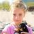 blond kid girl playing with puppy dog smiling stock photo © lunamarina