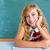 mosolyog · iskolás · lány · gondolkodik · iskolatábla · iskola · diák - stock fotó © lunamarina