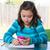 teen girl with smartphone doing homework stock photo © lunamarina