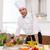 mosolyog · szakács · befejezés · gyümölcssaláta · konyha · étel - stock fotó © lunamarina