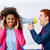 businessman shouting megaphone to african woman stock photo © lunamarina