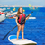 Kid paddle surf surfer girl with row in the beach stock photo © lunamarina