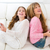 kid girls having fun playing back to back with tablet pc on sofa stock photo © lunamarina