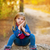 blond kid girl pensive in the forest outdoor sitting stock photo © lunamarina
