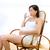 piękna · kobieta · w · ciąży · pitnej · mleka · domu · biegun - zdjęcia stock © lunamarina