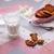 copo · leite · pão · de · especiarias · bolinhos · branco · mesa · de · madeira - foto stock © lunamarina