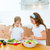 Beautiful chef sisters at home kitchen preparing salad stock photo © lunamarina